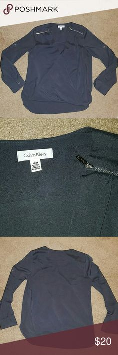 Calvin Klein Wrap Front Blouse This gray blouse features silver zippers on the shoulders, silver button on cuff and for rolling up the sleeves and a wrap front with a panel behind.  Like new, looser fit on medium, could fit a large too Calvin Klein Tops Blouses