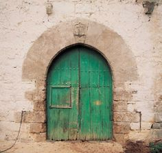 Ogival arches in carved stones over 16th century farmhouse door in Altzo, province of Gipuzkoa, in Basque country