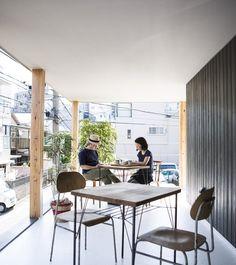 furuya design lifts upper level of japanese house to form sheltered balcony