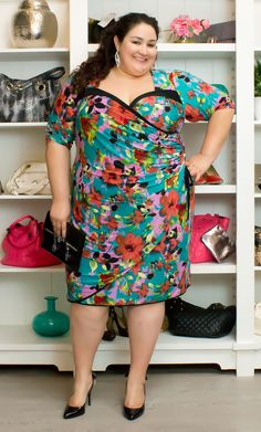 """Say hello to Spring in with color and style! Kiyonna Wholesale Manager Vannessa (3x, 5'8"""") is rockin' her curves in the Portia Pin Up Dress.  She tempered the bold print of the dress with simple black pumps and a clutch, with just a hint of sparkle with her earrings.  #Kiyonna  #KiyonnaPlusYou  #PlusSize"""