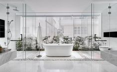 White and transparency rule in this stunning contemporary bathroom | Greja House | Singaore | Park & Associates