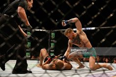 Conor McGregor of Ireland (top) punches Jose Aldo of Brazil in their UFC featherweight championship bout during the UFC 194 event inside MGM Grand Garden Arena on December 12, 2015 in Las Vegas, Nevada.
