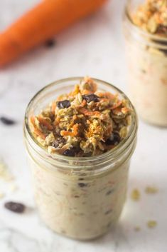 one mason jar with carrot cake overnight oats in it, and a carrot in the background