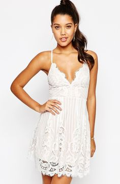 Love Trial scalloped lace slip dress: http://www.stylemepretty.com/2016/03/22/lace-dresses-perfect-for-spring/
