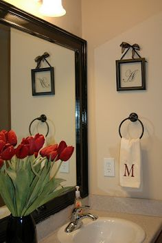 This is our master bathroom mirror after we framed up the plain boring contractor mirror! I LOVE IT! ~ALM