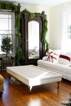 A simple bow turns your sofa pillows into Christmas decorations!! I LOVE the two-tone bow!