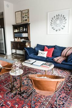 Vintage Home An Industrial Eclectic Bachelor Pad in Texas — House Call - Matthew moved back to his hometown of Fort Worth after 10 years in New York City. Blue Couch Living Room, Rugs In Living Room, Home And Living, Living Room Designs, Living Room Decor, Living Room Oriental Rug, Leather Living Rooms, Red Persian Rug Living Room, Decor Room