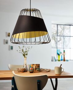 Wrapped with a black shade with gold interior, this pendant is perfect for modern and classic households alike. Whether it be a dining room, kitchen, or lounge. Cage Pendant, Caged Lamp, Black Cage Pendant, Lamp Decor, Bronze Cage, Gold Interior, Vintage Lighting, Dimmable Lamp, Dining Table Lighting