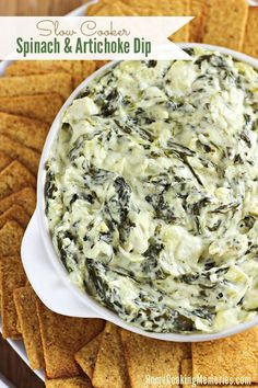 Need an easy, cheesy dip recipe? This Slow Cooker Spinach and Artichoke Dip is deliciously healthy!