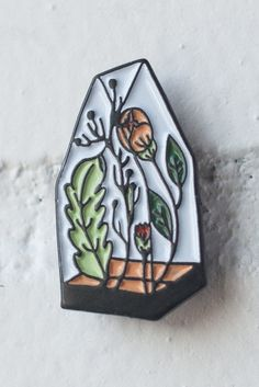 """Soft enamel and black nickel lapel pin. Small and subtle at 1"""" tall x 0.5"""" wide- just the way we like it. Comes on card backing."""