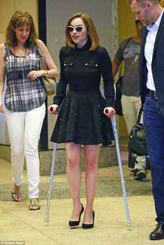 Kha-lean-si! Emilia Clarke beamed happily in New York on Wednesday despite still being stuck on crutches