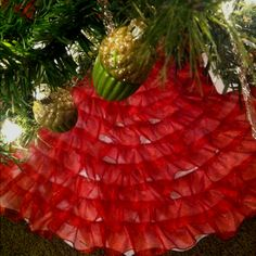 Tree skirt I made from a dollar tree felt skirt and a roll of wired ribbon