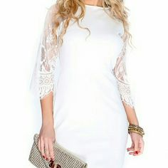 NWOT. White dress with lace back Gorgeous white dress with a lace back and sleeves. Brand new never used. Chupchick Dresses Mini