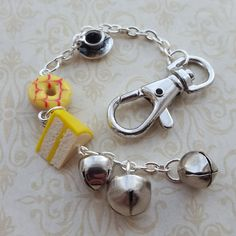 Planner charm, polymer clay cake, tea cup an bells accessory, polymer clay charm with lobster clasp, purse or bag charm, planner accessory by chapelviewcrafts on Etsy