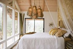 Kristie Wolfe *Note: I love the huge wall of windows in the bedroom, waking up to the sight of nature would be a pleasure! I also like the simple, minimalist feel of the room