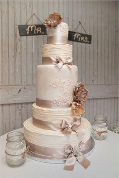 regal looking wedding cake with burlap flowers #weddingcake #rusticwedding #weddingchicks http://www.weddingchicks.com/2014/02/10/i-heart-fall-wedding-inspiration/