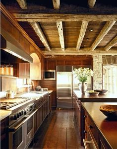 This kitchen is a dream!!! I would add a granite or stained concrete counter tops, instead of stainless fridge I would probably have it look like the cabinets an make sure that the space is very open with the living area