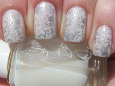 Lovely silver over white manicure, I could see this being lovely for a wedding manicure.