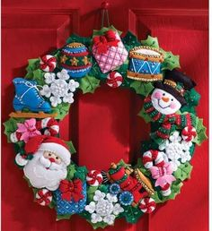 Bucilla Felt Applique Wall Hanging Wreath Kit, 15 by 86363 Christmas Toys: Bucilla felt applique wall hanging kit - Christmas Toys Wreath. Kit includes stamped felt, embroidery floss, beads, needles and trilingual instructions. Candy Wreath, Felt Wreath, Wreath Crafts, Felt Crafts, Wreath Ideas, Burlap Wreath, Felt Christmas Ornaments, Christmas Toys, Christmas Stockings