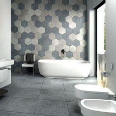 A grey hexagon tile bathroom feature wall - this is about as on-trend as it gets. Hexagon Tile Bathroom, Bathroom Tile Designs, Hexagon Tiles, Bathroom Interior Design, Modern Bathroom, Small Bathroom, Bathroom Feature Wall Tile, Bathroom Ideas, Bathroom Tubs