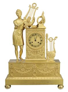 Lot 877 of January 12-13, 2013 Sale - Fine Empire Gilt Bronze Shelf Clock -  French, 19th century, standing figure of classical youth holding a lyre, other musical motifs including pan pipes, rectangular base with extensive fine swag and wreath decoration, with key and pendulum, 24-1/4 x 16 x 5-1/4 in. - Estimate $1,000 to $2,000