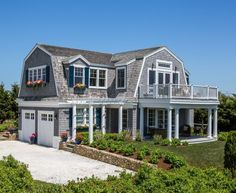There are some types of roof that would create a traditional house style and a gambrel roof is one of them. A gambrel roof is a symmetrical two-sided roof that has two slopes on each side of the ro… Beach Cottage Style, Coastal Cottage, Beach House, Seaside Style, Coastal Style, Dutch Colonial Homes, Dutch Colonial Exterior, Storybook Homes, Gambrel Roof