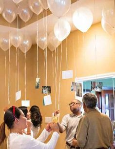 photos hanging from balloons