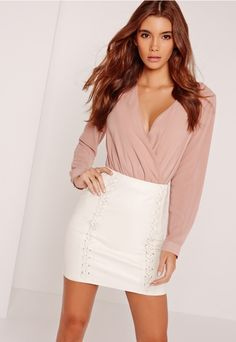 Toughen up your look in faux leather in this sexy mini skirt with whipstitch front deets.