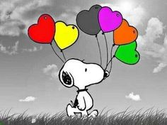 Snoopy with colorful heart-shaped balloons.