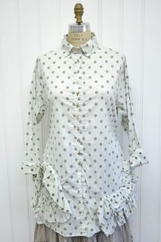 """Features: Beautiful shirt Full hem Raw edge ruffled detail along bottom Side ties 100% Polka Dot Cotton, Cream/Dark Oat Fits sizes 2-14 Measurements: Chest: about 46"""" around Length: about 33"""" from high shoulder"""