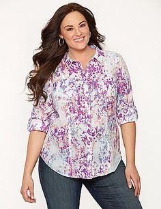 Classic collared shirt offers a timeless cut and endless versatility to your Spring closet with a feminine watercolor motif and double chest pockets. Button-down closure, vertical fashion seaming and rolled, tab & button sleeves keep the look ready for anything. lanebryant.com