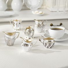 Set of Six Silver Creamers