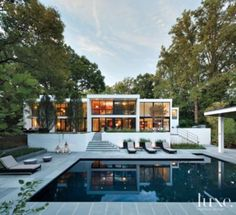 Modern design | Bluestone #pavers surround this #Baltimore home's #pool. See more at www.luxesource.com.