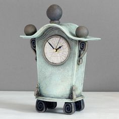 quirky ceramic mantel clock - medium - light blue with charcoal decoration by ian roberts