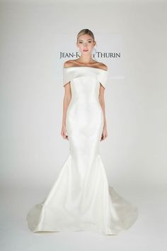Jean-Ralph Thurin high fashion off-the-shoulder chapel train mermaid white satin wedding dress. Pinned by BrideBug.com