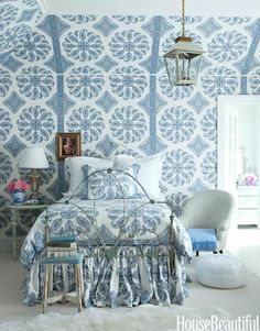 "Windsor Smith describes this bedroom as ""young Indian princess meets modern preteen"". Walls are covered in Peter Dunham's Samarkand."