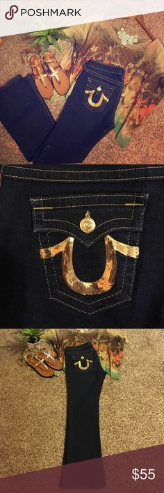 "Jeans, True Religion, Size 30, inseam 31. 6"" Zip Super cute all bold gold accent true religions. Stretchy, super stretchy, super dark denim, straight leg cut, waist is 30 inches inseam is 31 inches zipper is 6 inches,  button to crotch is 8 inches, sits below the belly button. In excellent shape excluding the hole in the left leg behind the knee Sea fourth picture. True Religion Jeans Straight Leg"