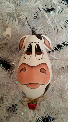 DIY hand-painted cow ornament made from a gourd.