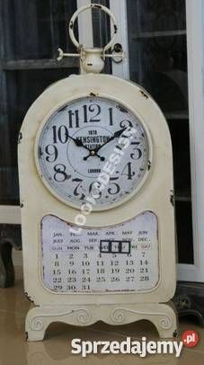 Biały zegar kalendarz z kolekcji Retro    Elegancki, jasny zegar w stylu retro, Wykonany z metalu barwy kremowobiałej z ciemnymi przecierkami Pięknie stylizowany z tarczą barwy białej i kalendarzem Piękna dekoracja wnętrza. Doskonały do salonu lub gabinetu Wymiary: 30x8,5x64 CM Polecamy inne nasze zegary. Przy zakupie kilku przedmiotów jeden koszt przesyłki!!!  W przypadku pytań prosimy o kontakt tel: 793 93 29 93 e-mail: biuro.look4design@gmail.com  Zapraszamy również do naszego sklepu…