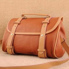 Fukiko, ladies fashion brown shoulder handbag. Brown shoulder #bag design, top single handle, adjustable & removable shoulder strap, 2 x main compartment with zip closure, 1 zip pocket, 1 mobile phone pocket & 1 ID pocket, external main cover with snap tab closure, external zip pocket on the rear. $73.00 - Out of stock