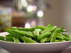 Sauteed Sugar Snap Peas recipe from Ina Garten via Food Network -- could also cook garlic in the oil first