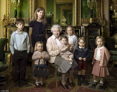 Two-year-old Mia Tindall stole the Queen's thunder in the Annie Liebovitz portrait released this morning by proudly posing with her great grandmother's handbag. The children are: James, Viscount Severn (left), 8, and Lady Louise (second left), 12, Mia Tindall; Savannah (third right), 5, and Isla Phillips (right), 3; Prince George (second right), 2, and in The Queen's arms, Princess Charlotte (11 months)