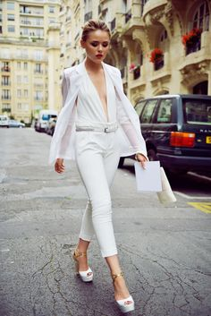 kristina going to the lancome party in paris waring a white pants from sara, a body suit from moeva london and a blazer from minusey