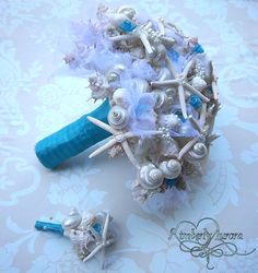 sea shell bouquet...not for my wedding, but I know of a few people doing a destination/beach wedding that this would be perfect for!
