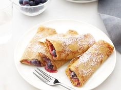 Crepes with Peanut Butter and Jam: Stuff easy homemade crepes with the combination of peanut butter, strawberry or raspberry jam and fresh blueberries.