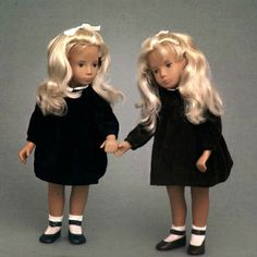"Pair of 15"" blonde Sasha Cord dolls in blue and brown variations, very early models with hand-painted faces (possibly prototypes), from the Design Council Slide Collection, United Kingdom, 1966, by Frido Ltd."
