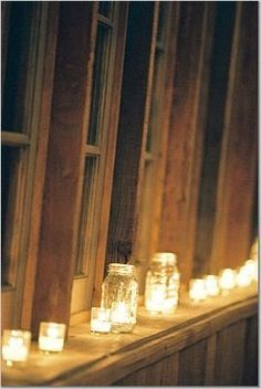 I love the mason jars as candle holders!