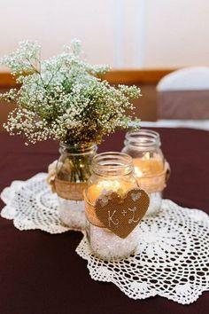 Rustic wedding centerpieces - mason jars, baby's breath and crocheted doilies / http://www.himisspuff.com/rustic-wedding-centerpiece-ideas/13/