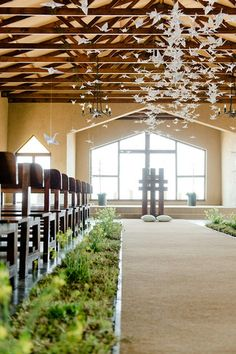 """Origami Bird Hanging Decor: Their beautiful wedding ceremony chapel venue was decorated with endless floating origami birds suspended from up above from """"rosyntjiebos"""" branches with grass lanes running down the aisle. See more of this Rock Roses Chapel Wedding, Farm Wedding, Wedding Ceremony, Wedding Venues, Wedding Places, Reception, Rose Wedding, Dream Wedding, Origami Wedding"""