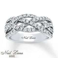 Rows of dazzling diamonds weave together to form this glamorous anniversary band from Neil Lane Bridal®. Crafted in 14K white gold, the ring has a total diamond weight of 1 carat and features Neil Lane's signature inside the band. Diamond Total Carat Weight may range from .95 - 1.11 carats.
